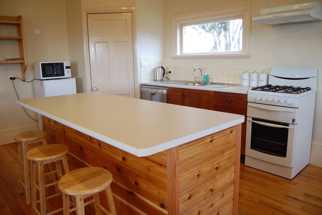 Open kitchen area with breakfast bar and fully equipped kitchen