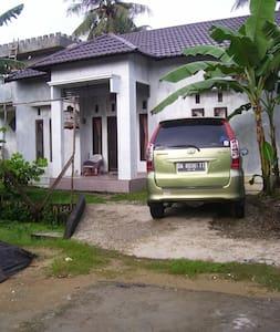 Raja & Sultan's Home - House