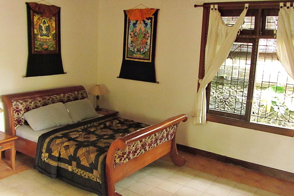 Comfy Queen size bed for sleeping surrounded by the protection of the Tibetan sacred art.