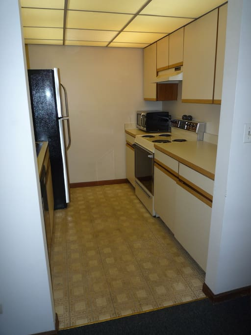Fully equipped kitchen with stove, micro, dishwasher, toaster, utensils, plates, pots, etc