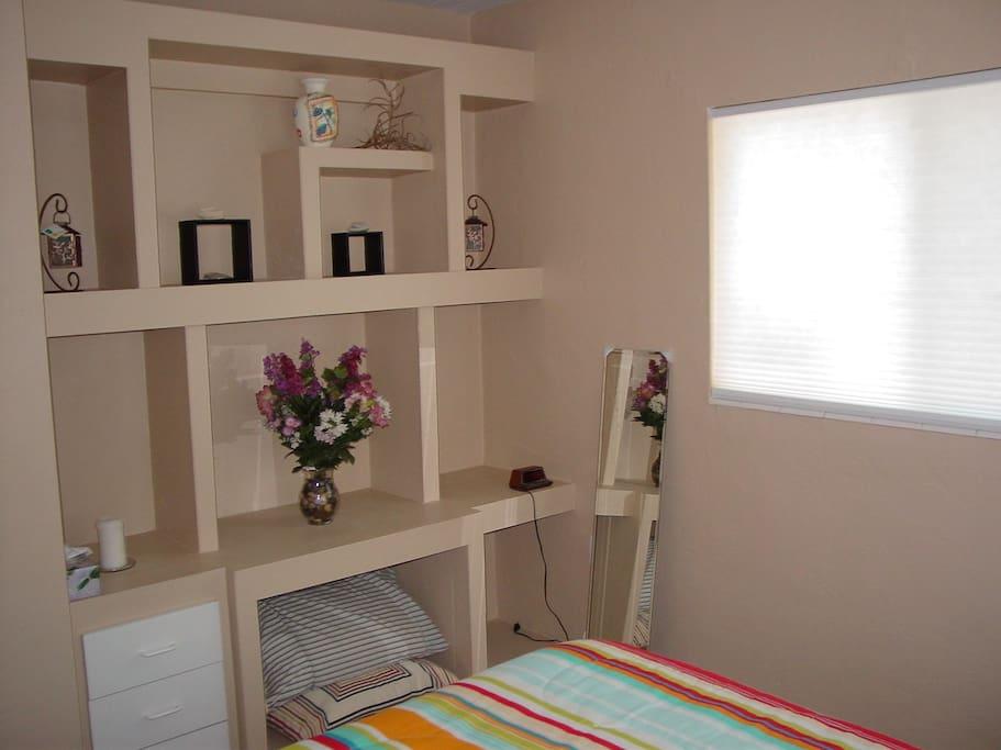 Storage area in bedroom