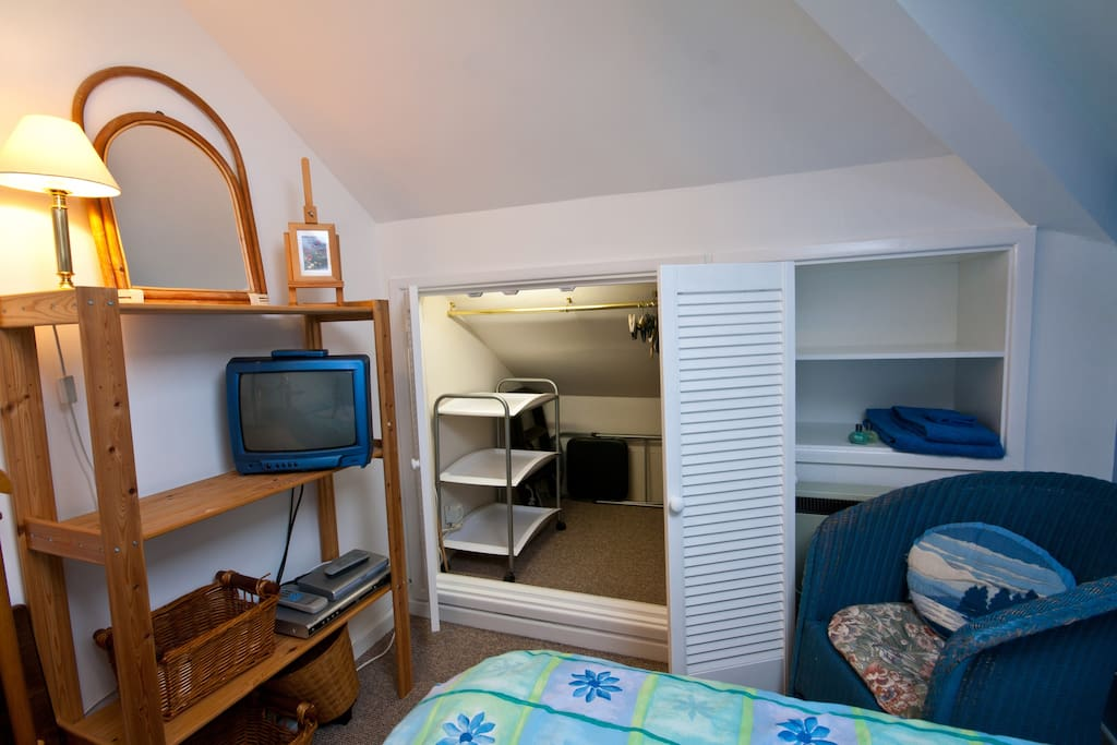 Ample built in storage. There is a new flat screen TV with built in Freeview in the room now as well as a DVD player.