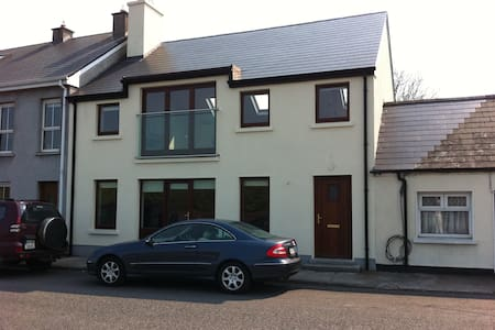 Open plan, newly built, spacious modern house with views over the estuary of the River Moy, Killala Bay and the Atlantic Ocean.  Located in the middle of the Quay Village, right beside restaurants pubs and shops. Short distance to Enniscrone Beach.