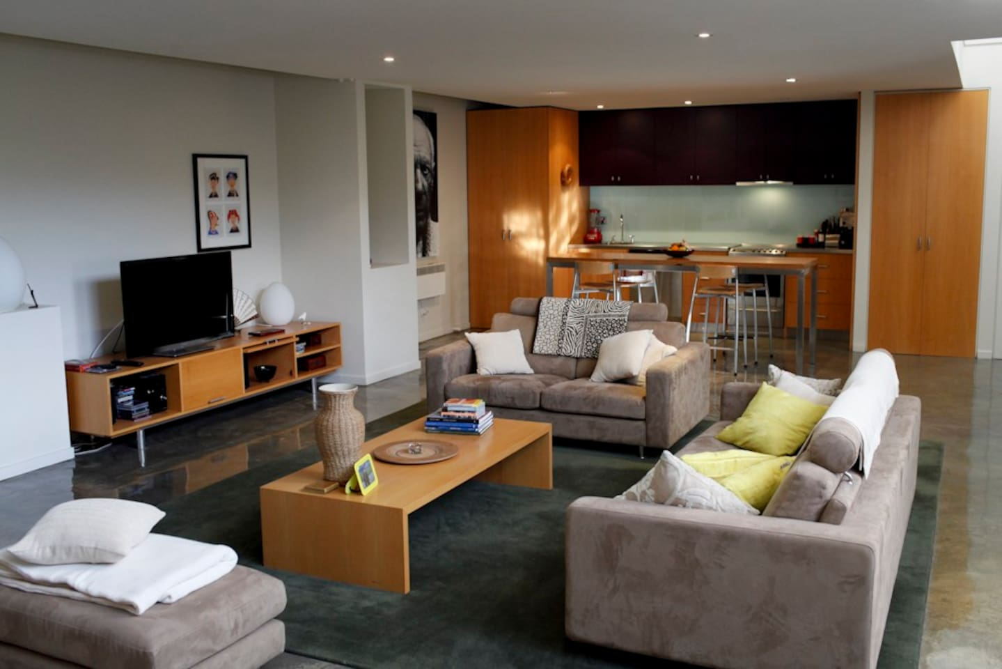 Lounge room TV and kitchen eating area