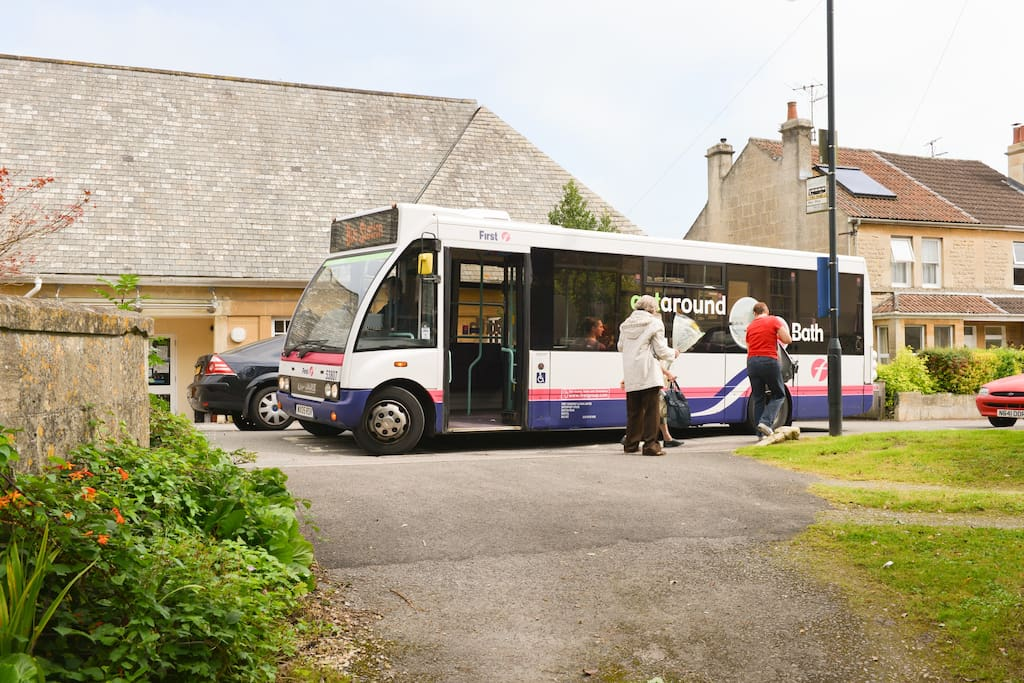 The number 1 bus - 8 minutes from the bus/train station. Our gate is behind the camera - - - -