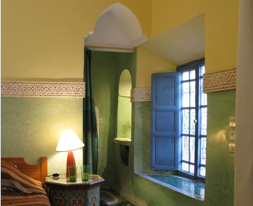 This is a corner of the large single bed, and a glimpse of the shower room