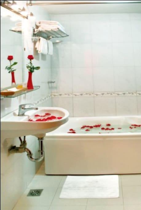 Ensuite bathroom with bathtub