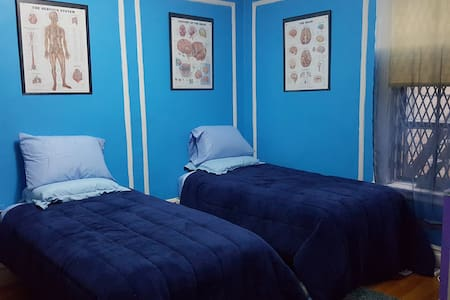Big room in a spacious pre-war apartment, close to both the city's frenetic energy and its peaceful side.  2 minutes East to Broadway, 8 minutes to 1/A/C subway, 2 minutes West to Riverside Park.  Your room: wifi, cable TV, fridge, A/C, coffee.