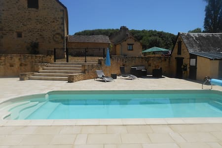 Stone barns with swimming pool - House