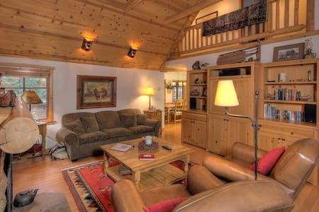 Located just south of Tahoe City, this Old Tahoe style Sunnyside vacation rental cabin offers a tenant the best of the old and the new. The rental cabin has been extensively remodeled and features Douglas Fir floors, rock fireplace with vaulted wood
