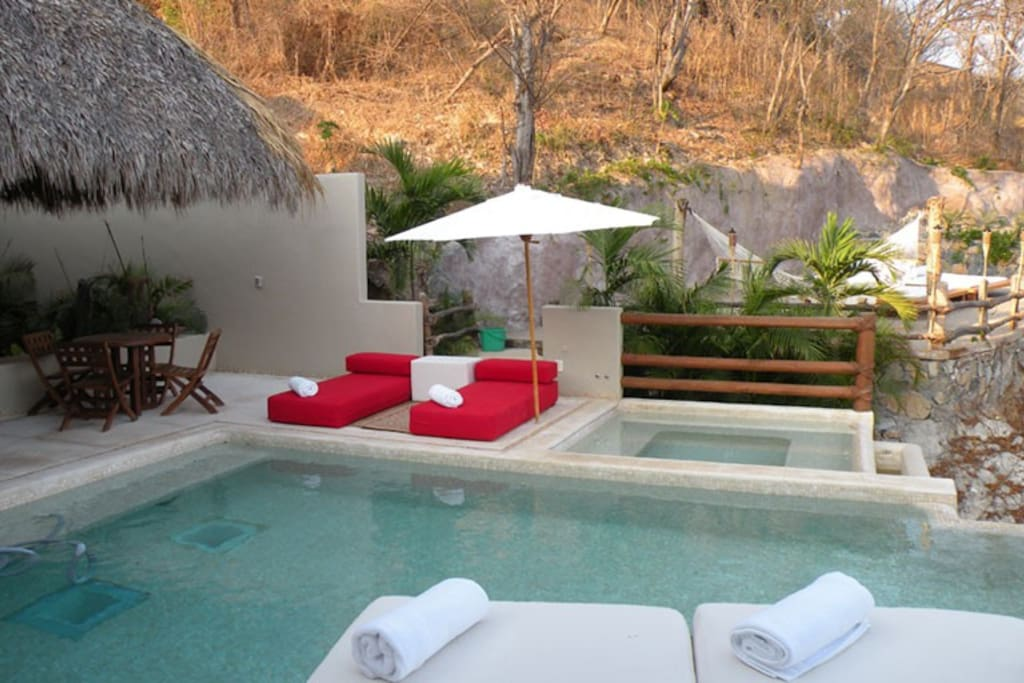 Private infinity pool, Jacuzzi and sun-tanning area with hammocks