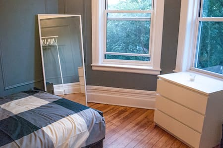 Located on a beautiful, quiet, tree-lined street in Brooklyn. The room has two giant windows and is located in the front of the apartment which makes it feel like you have the whole place to yourself! There's also a rooftop and laundry in building!