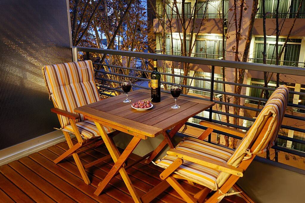 Enjoy meals or taste some Argentine Malbec in your private balcony.