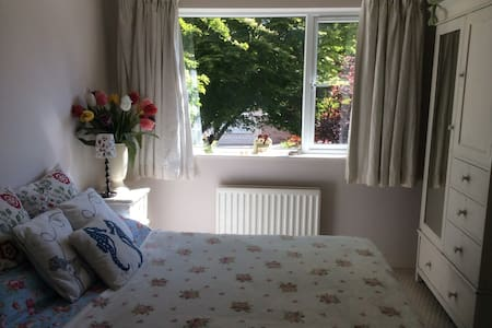 The room is a clean, bright, airy space, looking onto the garden on the ground floor. It has a homely feel and consists of a wardrobe, chest of drawers, side tables and occasional chair.  Beside this room is a luxury shower room, breakfast / TV room