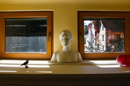 live in a house with amarble statue