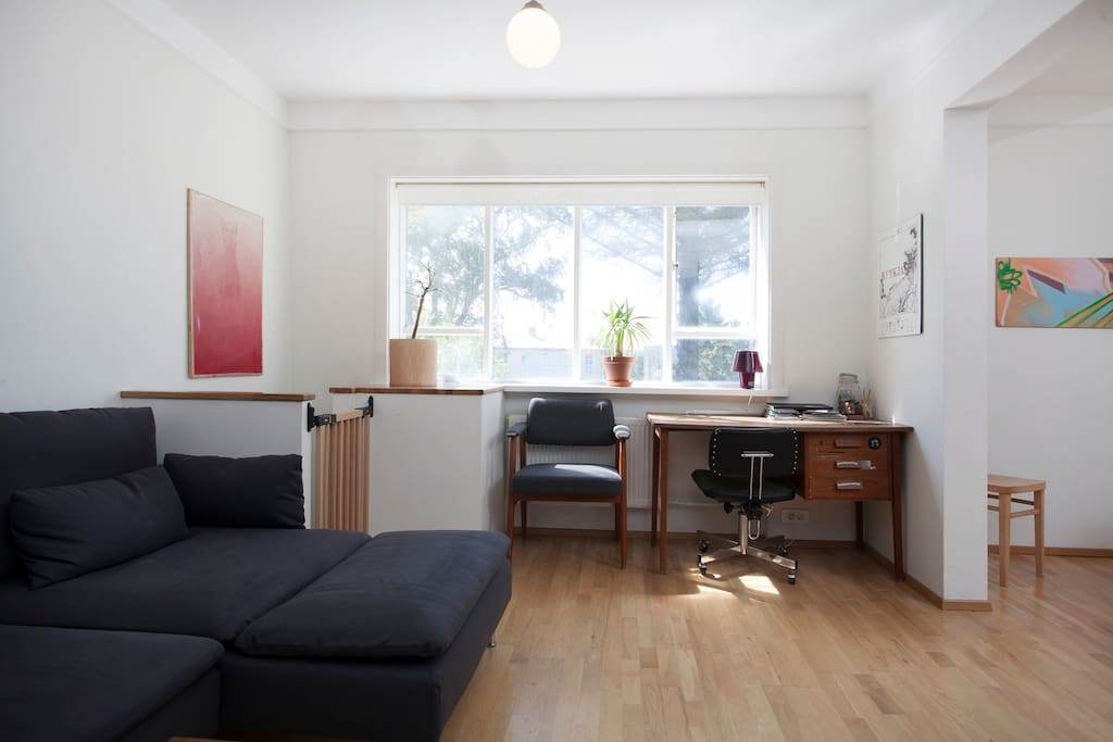 The living room has a small desk for writing or working