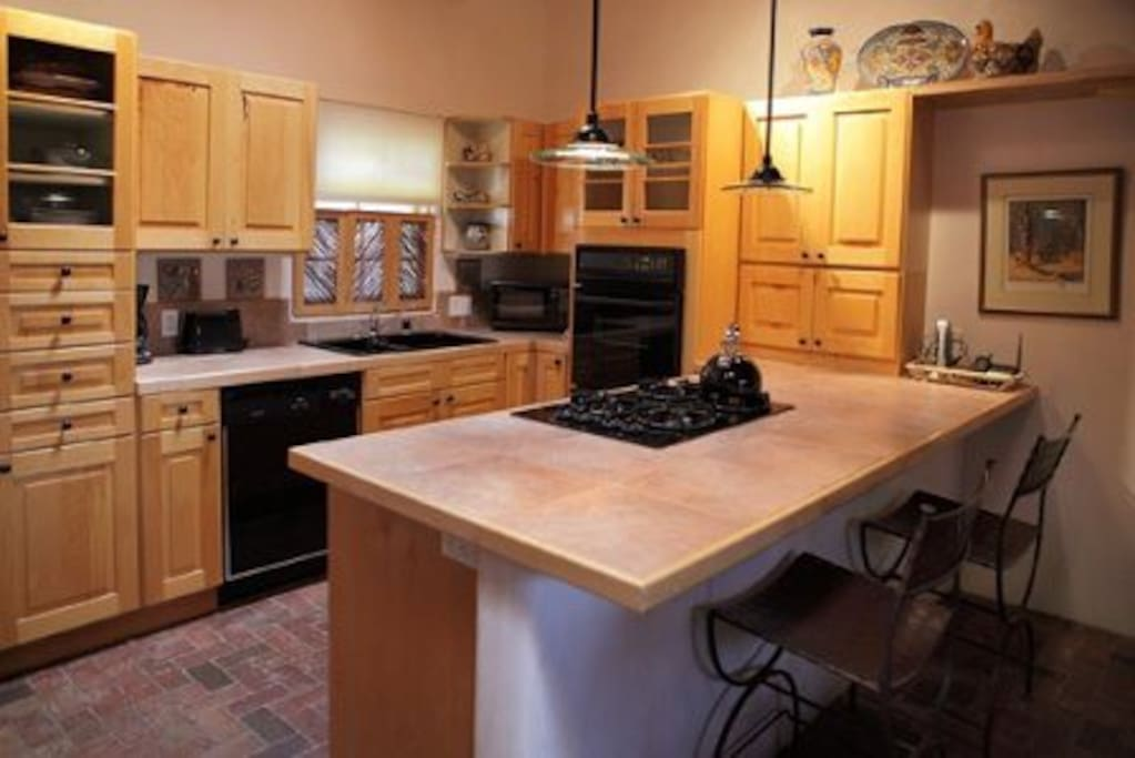 Fully equipped kitchen with skylight, breakfast bar, phone and fax (in cabinet)