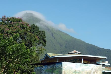 Gaia Zoe is a beatiful house with 4 bedrooms located just 5 minutes drive from La Fortuna downtown in a very private, secure and secluded area; Arenal Volcano is just in the back side of the property and lovely surroundings with lots of fruits trees.