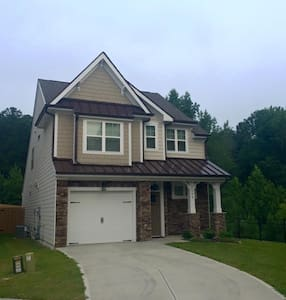 Brand new home built in 2014. Very nice and clean with a great view of the lake right outside the windows. Lofted upstairs with an extra room just for you and your +1.   Just minutes from DT Raleigh and a typical Uber ride cost just $8 to get there.