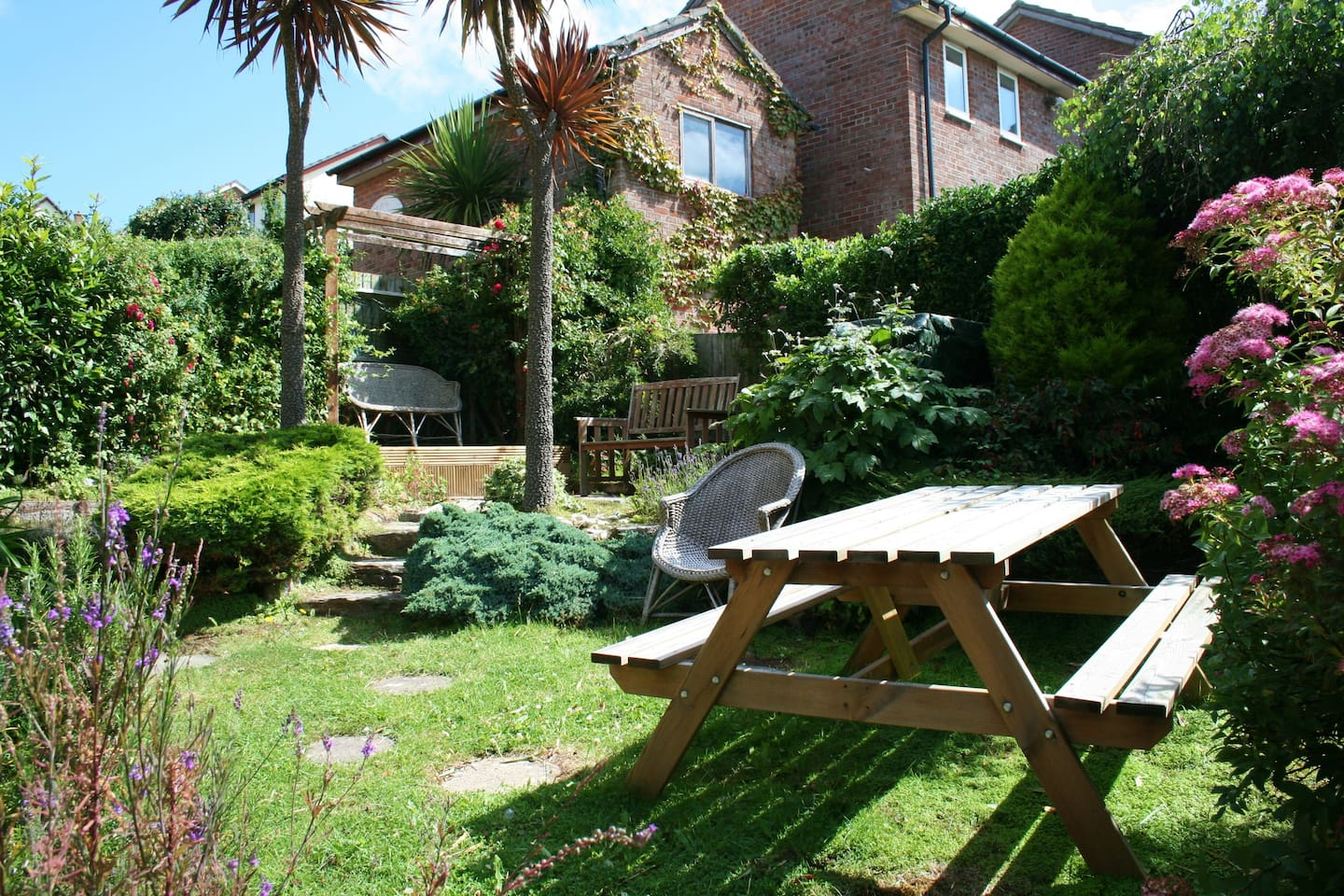 Landscaped Gardens with BBQ and Seating
