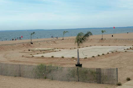Water view, beach and boardwalk.