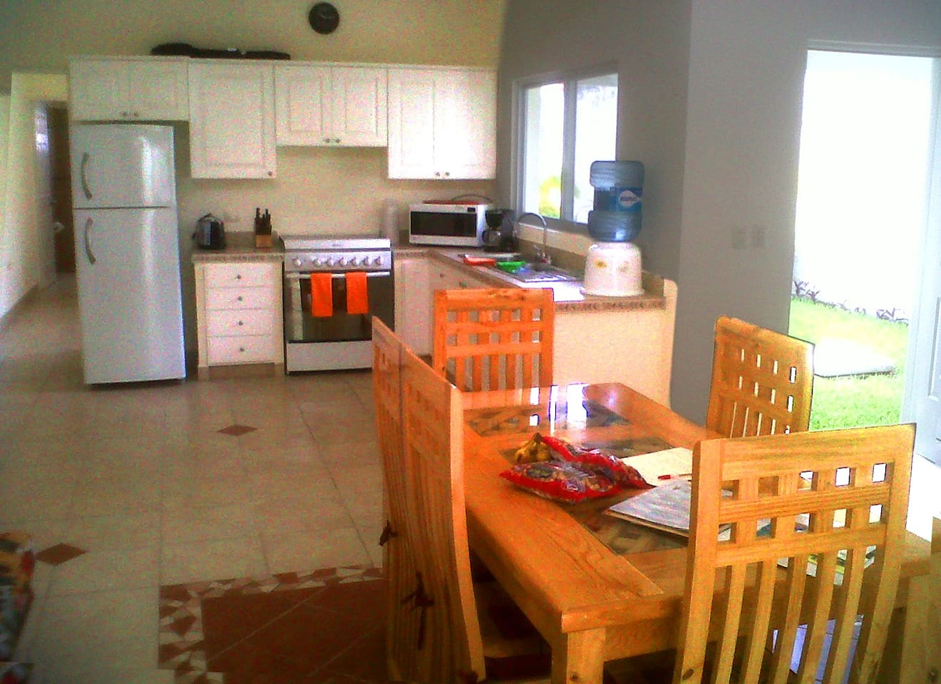 Full kitchen with spacious dining area.  Very open space with a lot of natural light.  No air conditioning in this area.