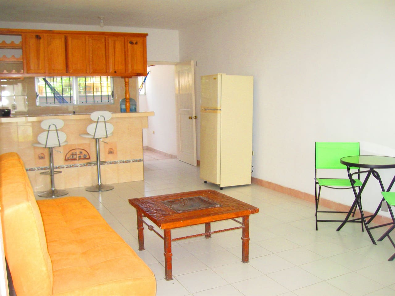 Comfortable living area with full kitchen. Porch room with hammock