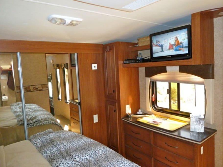 Master Bedroom. Ample closet w/ sliding mirror doors. Built in Chest of drawers w/ Corian countertop. Flatscreen TV w/ Satellite channels