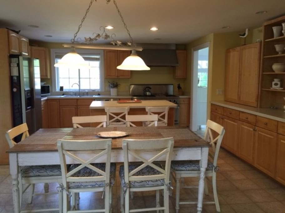 Large spacious kitchen with plenty of cabinets and lots of cooking space. A gourmet chef would be happy cooking here