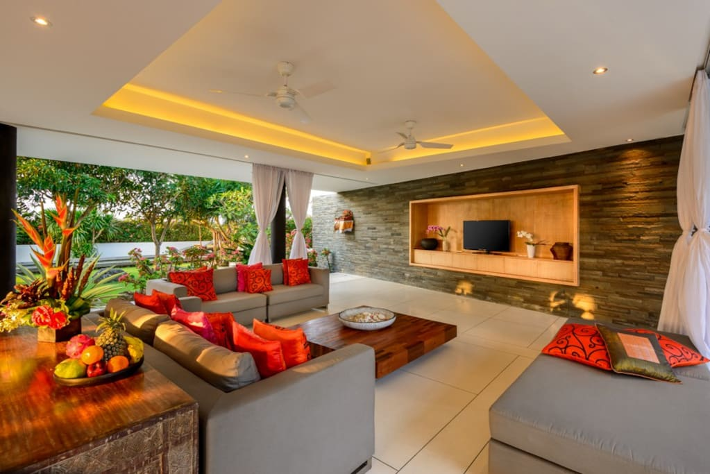 Open living area stays naturally cool due to the clever architectural design of the villa, leaving the living area comfortable. It is a seamless indoor to outdoor area which can be easily closed off with cafe blinds.