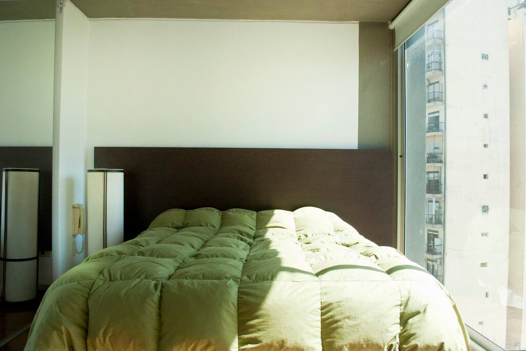 Queen size bed. Large window with blinds