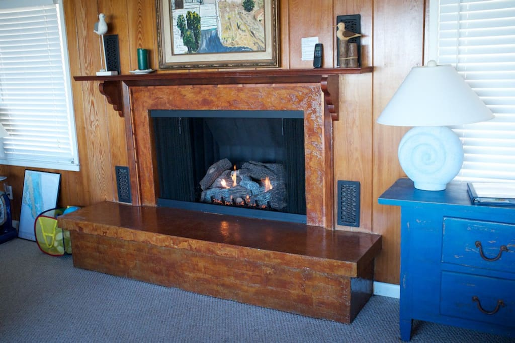 Gas fireplace that operates with cick-to-light remote control - really warms the house up in off season.
