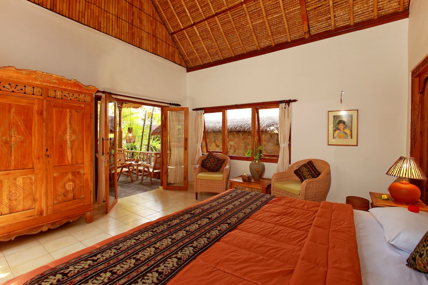 Our elegantly simple rooms are light filled airy and spacious with views of the pool, garden and rice fields.