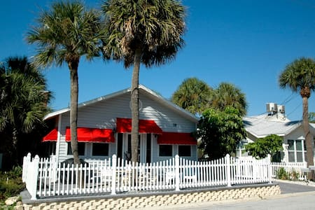 This is truly a unique find on the island of Clearwater Beach! This Cottage adds up to 3 bedrooms, 3 baths, 2 kitchens and two sets of washers and dryers! This is a great value in a recently updated Cottage just steps to the sand.