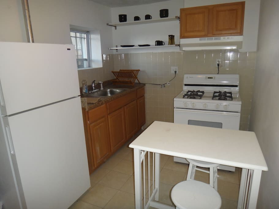 fully equipped kitchen with essentials. microwave & coffee maker available.