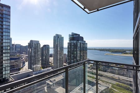 Prime location is steps from the waterfront, Entertainment, Financial and Fashion districts. Enjoy a panoramic view of the lake and city lights from our balcony.