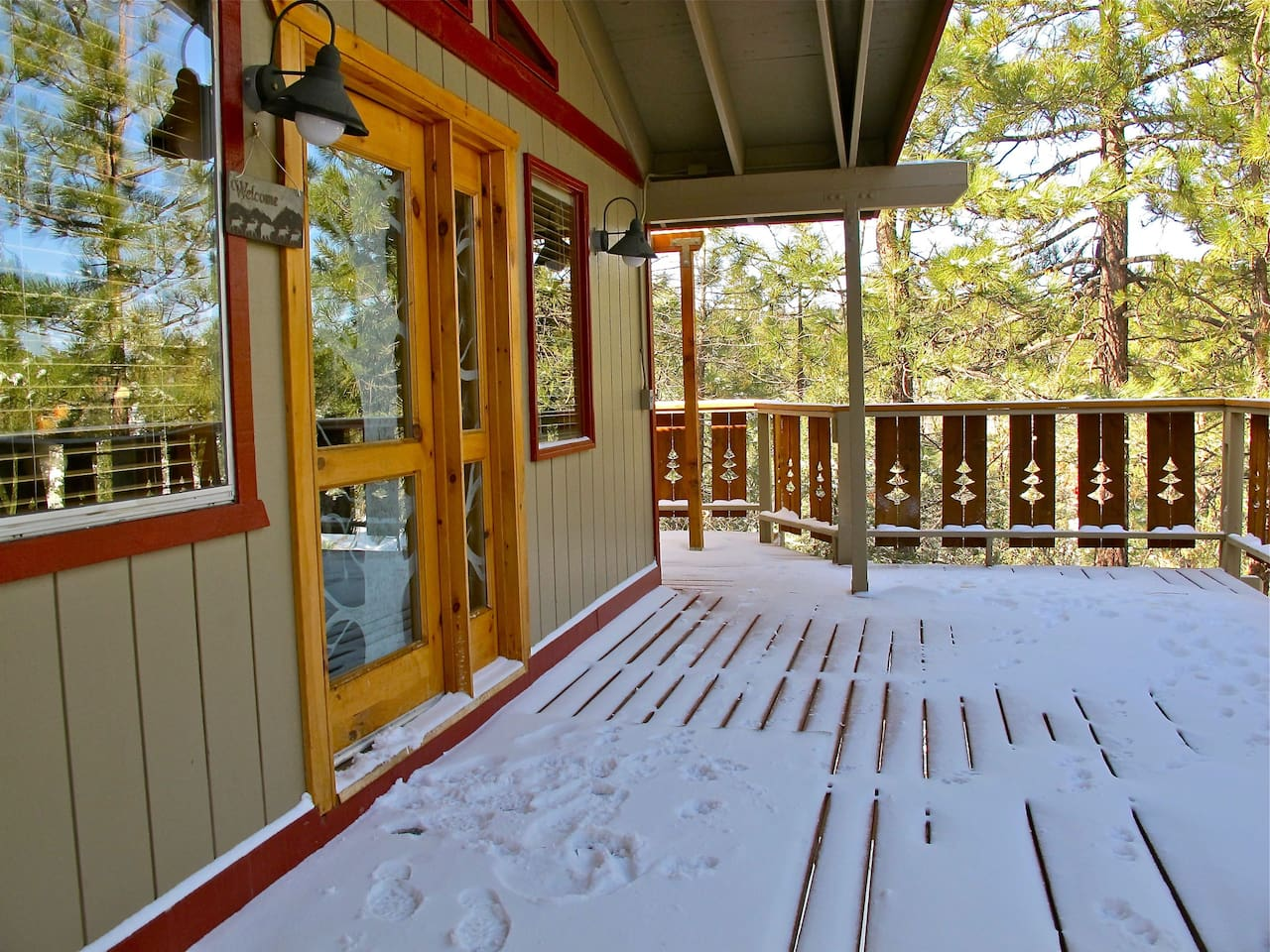 Front entrance and our spacious balcony looking out to tree top.