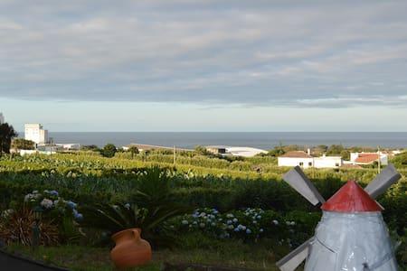 Suite com jardim e vista panorâmica - Lagoa - House