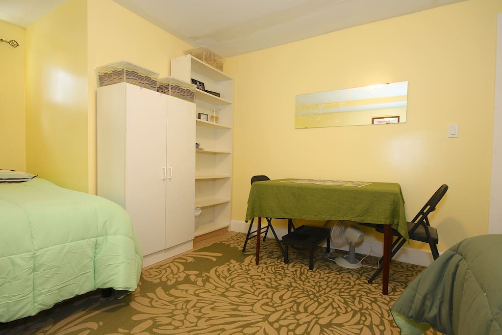 Guestroom (one room) with two double/full sized beds sleeps 4 guests, located in lower level.