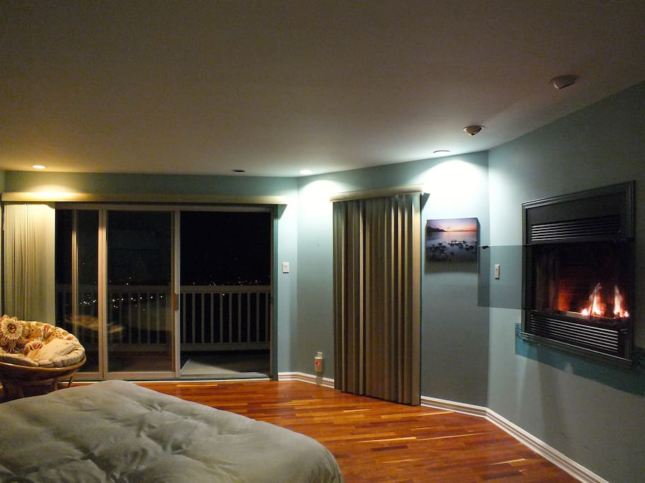 lay in bed while enjoying the fire place