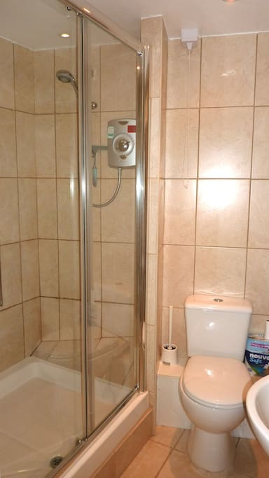Large shower cubicle with instant hot water