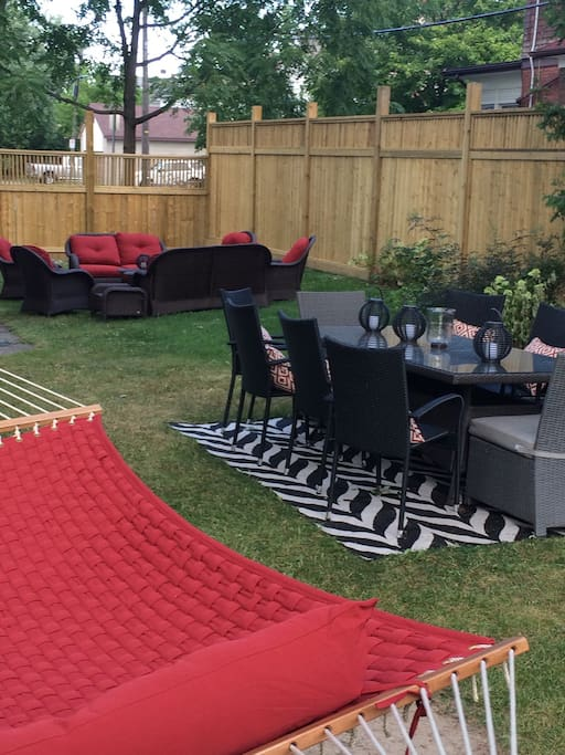 hammock for two, seating for 12 at the table and sofa area( side of yard)