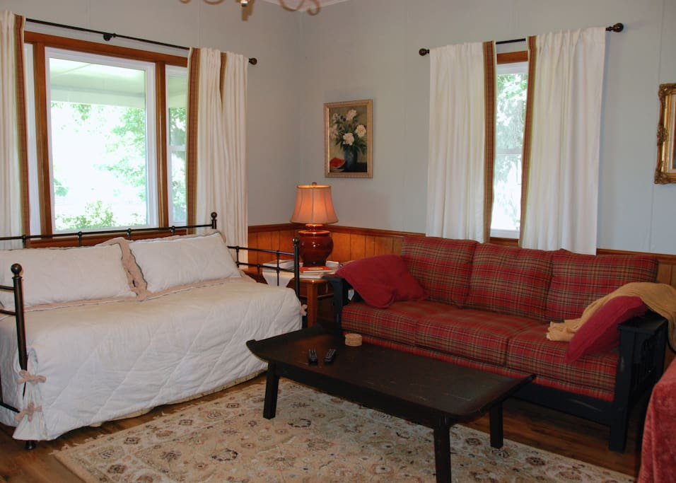 Spacious living room includes a day bed with trundle.