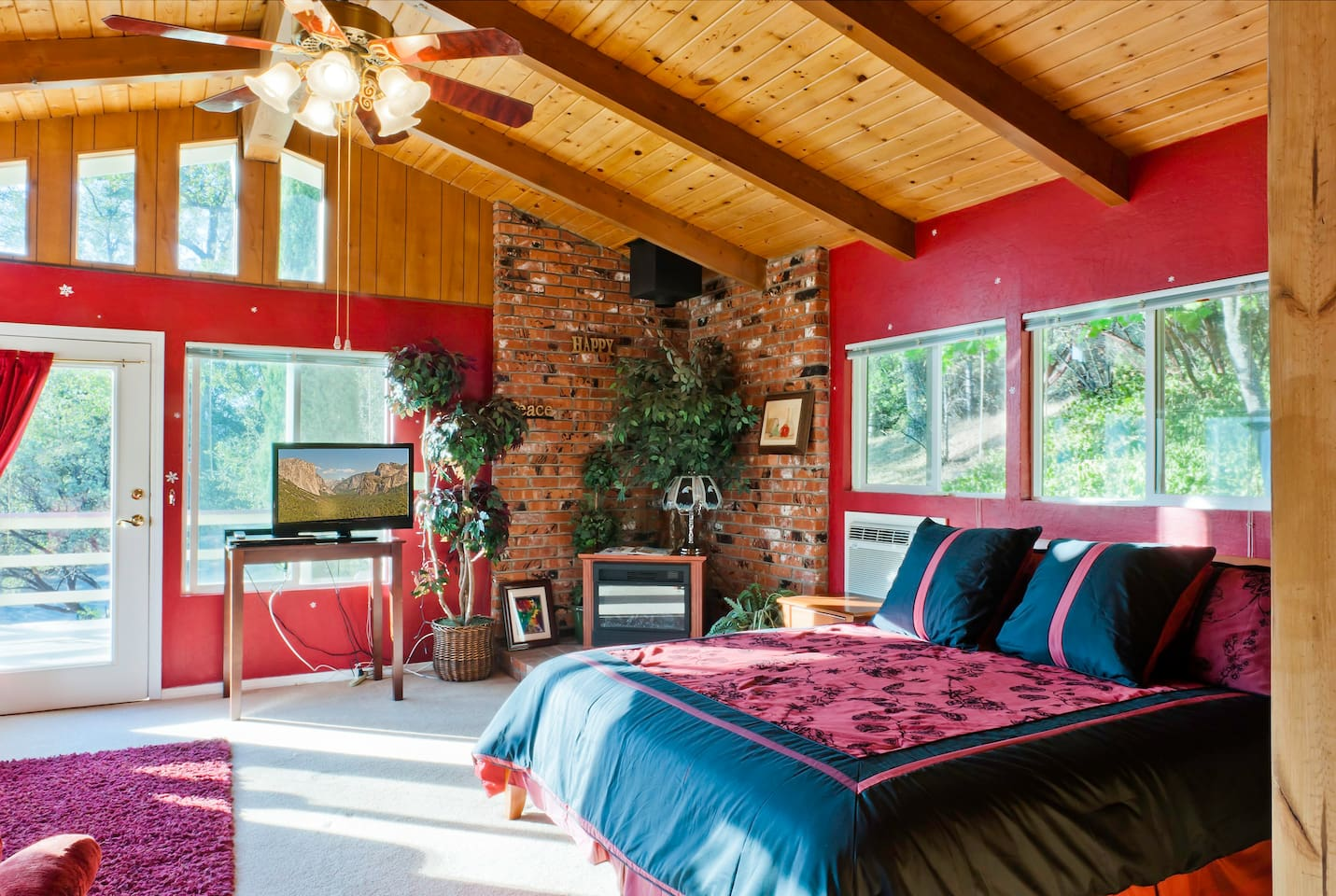 The Red Rose with its own private deck, private entrance, cabin-like ceiling, jetted tub, separate shower, double sinks, king-sized bed and futon, and gorgeous views!