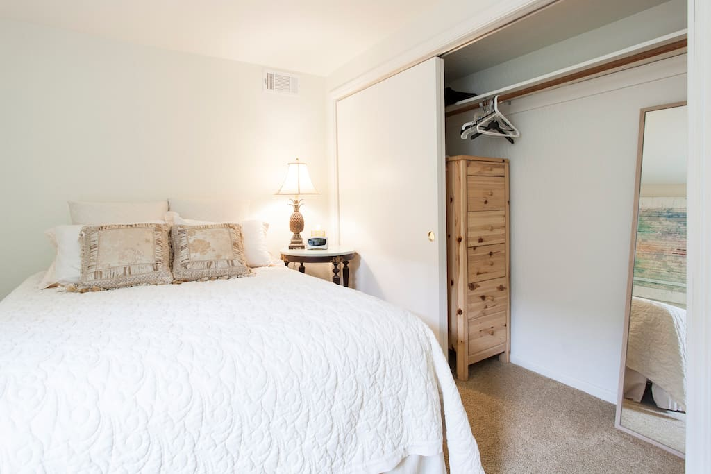 Closet with extra linens and pillows, along with space to hang your clothes!