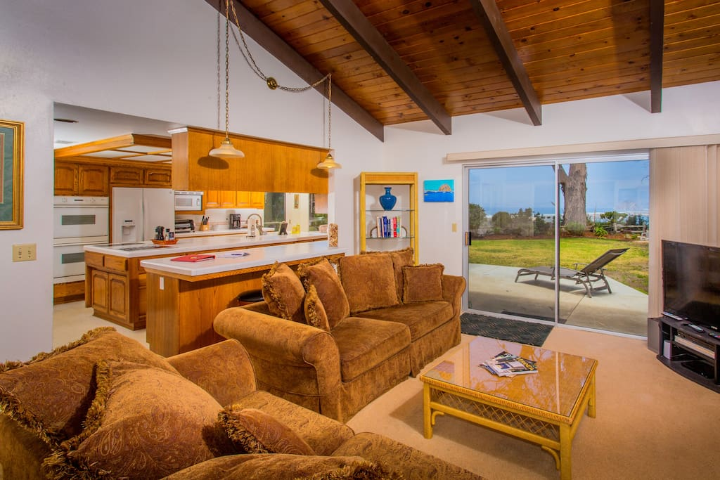 """Two large comfortable sofas to relax and watch turkeys, deer or the 50"""" flat screen TV.  Looks through to the recreation room and kitchen."""