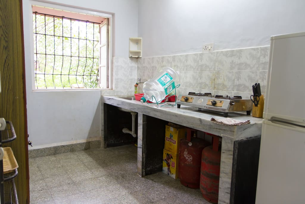 Kitchen Area: Fridge / Freezer, Gas Cooking Stove, Kitchen Sink