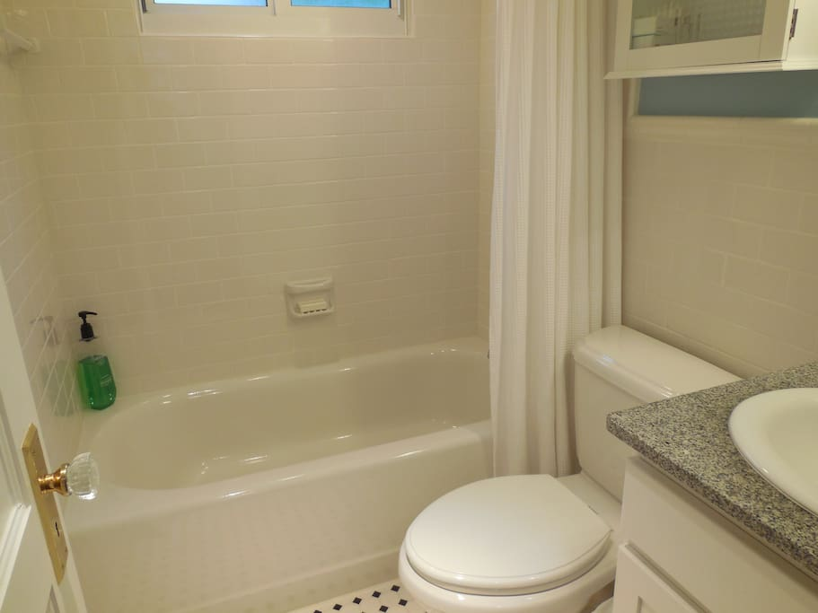 This is a sparkling clean bathroom with a full bathtub and shower combination.  It is well-stocked with luxury linens, bath products and a blow dryer for your use.