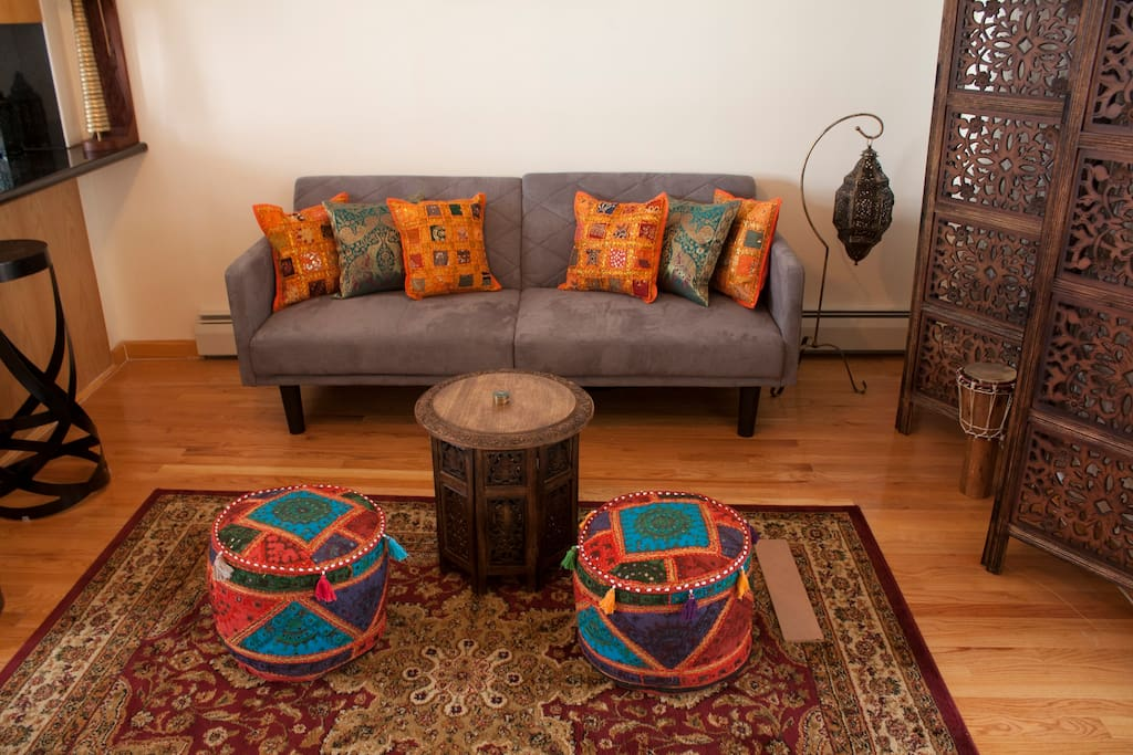 Comfy Morrocan styled living room. The bed folds down to a couch too.