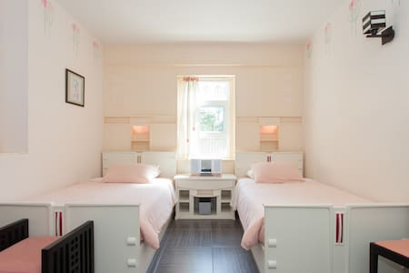 Inspired by the great Art Nouveau designer Charles Rennie Mackintosh and offers two twin beds, a writing desk, an en suite bathroom, and a window view of the fountain courtyard. A short, scenic drive from downtown. Breakfast is included - our treat.